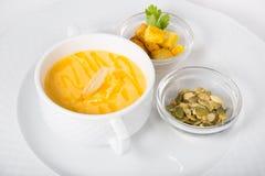 Yellow pumpkin soup stock photo
