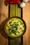 Yellow pumpkin soup with croutons and parsley. On the table, view from the above stock photos