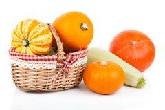 Yellow pumpkins vegetables in basket Royalty Free Stock Image