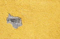 Yellow punched stucco. Yellow rough stucco, deeply punched. material texture Stock Image