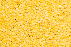 Yellow purified lentil closeup top view background. Stock Images