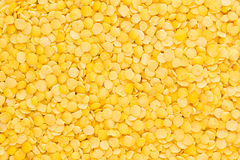 Yellow purified lentil closeup top view background. Stock Photography