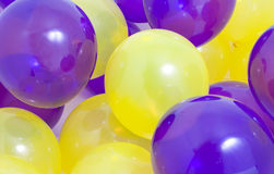 Yellow and Purple Balloons Background royalty free stock photo