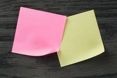 Yellow and purple sticky notes on wooden table Stock Photos