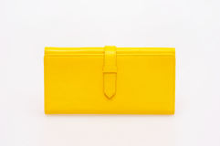 Yellow purse. On a white background royalty free stock photography