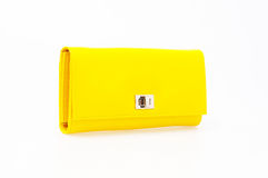 Yellow purse. On a white background stock images