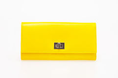 Yellow purse. On a white background royalty free stock image