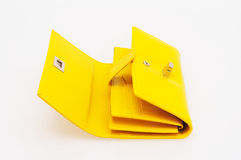 Yellow purse. On a white background royalty free stock photo