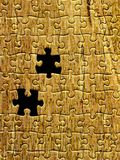 Yellow puzzle pattern with two missing pieces. Abstract colored background with yellow puzzle texture and missing pieces Royalty Free Stock Images