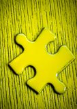 Yellow Puzzle piece Stock Photo
