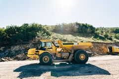 Free Yellow Quarry Dump Truck Driving On The Road Royalty Free Stock Image - 216937926