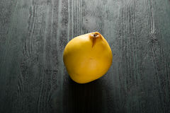Yellow quince on the dark table Royalty Free Stock Image