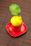 Yellow quinces with a green leaf Royalty Free Stock Photo