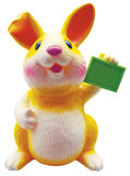 Yellow rabbit with green sign Stock Images