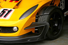 Yellow race car front tyre Royalty Free Stock Image