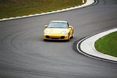 Yellow race car Royalty Free Stock Photo