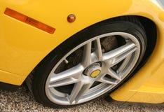 Yellow race car wheel. Light alloy wheel on a bright yellow super car Royalty Free Stock Photo