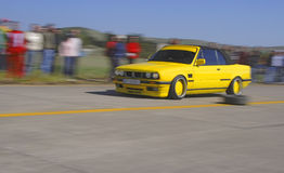 Yellow racing car royalty free stock images