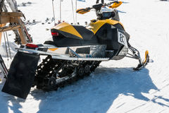 Yellow Racing Snowmobile in winter day Stock Photo