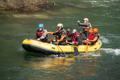Yellow raft team Stock Photography