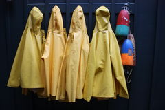 Yellow rain coats Stock Photography