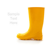 Yellow rainboots on white with copy space Stock Images