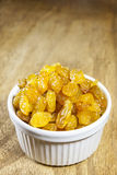 Yellow raisins or sultanas in a small white ceramic bowl Stock Photography