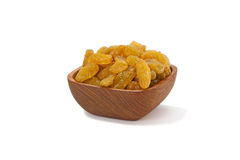 Yellow raisins in a wooden Pialat on white background. Pialat wooden with Yellow raisins  on white background Stock Photography