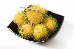 Yellow Rambutan Tropical Fruits. A plate of yellow rambutan, the tropical fruit stock images
