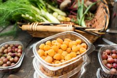 Yellow raspberries on farmer table. In a market gardening concept Royalty Free Stock Image