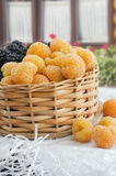 Yellow raspberries in a small wicker basket Royalty Free Stock Images