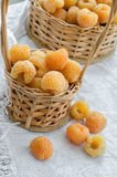 Yellow raspberries in a small wicker basket Royalty Free Stock Photo