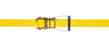 Yellow ratchet strap on a white background. A yellow ratchet strap on a white background royalty free stock images