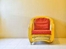 Yellow rattan armchair Stock Images