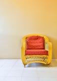 Yellow rattan armchair Royalty Free Stock Photo