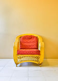 Yellow rattan armchair Royalty Free Stock Images