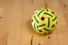 Yellow rattan ball with green stripes Stock Photos