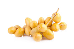 Yellow raw dates isolated on white background.  Royalty Free Stock Photography