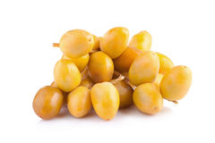 Yellow raw dates isolated on white background.  Stock Photography