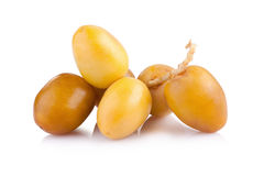 Yellow raw dates isolated on white background.  Royalty Free Stock Images