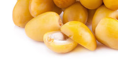 Yellow raw dates isolated on white background.  Royalty Free Stock Photo
