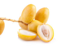 Yellow raw dates isolated on white background.  Royalty Free Stock Image