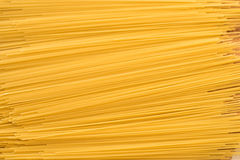 Yellow raw dry spagetti, background, texture Stock Photo