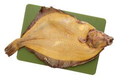Yellow  raw  flounder. Flounder is on chopping board Royalty Free Stock Photography