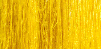 Yellow raw silk thread background Royalty Free Stock Photography