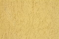 Yellow real plaster texture Stock Images