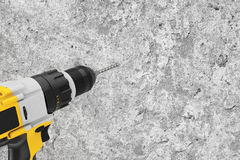 Yellow Rechargeable and Cordless Drill Drilling Hole in the Conc Stock Photos
