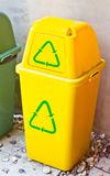 Yellow recycle bin Stock Photo