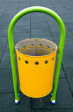 Yellow recycle bin on a playground Royalty Free Stock Photo