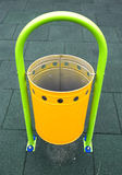 Yellow recycle bin on a playground Royalty Free Stock Images